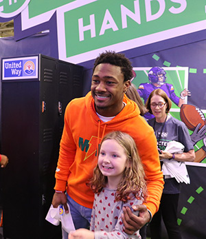 United Way at Super Bowl Experience - Stefon Diggs and fan